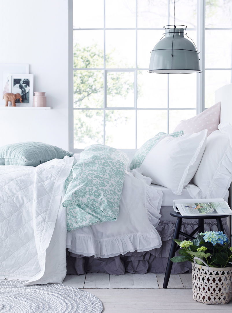 Ellos vuodevaatteet makuuhuoneessa